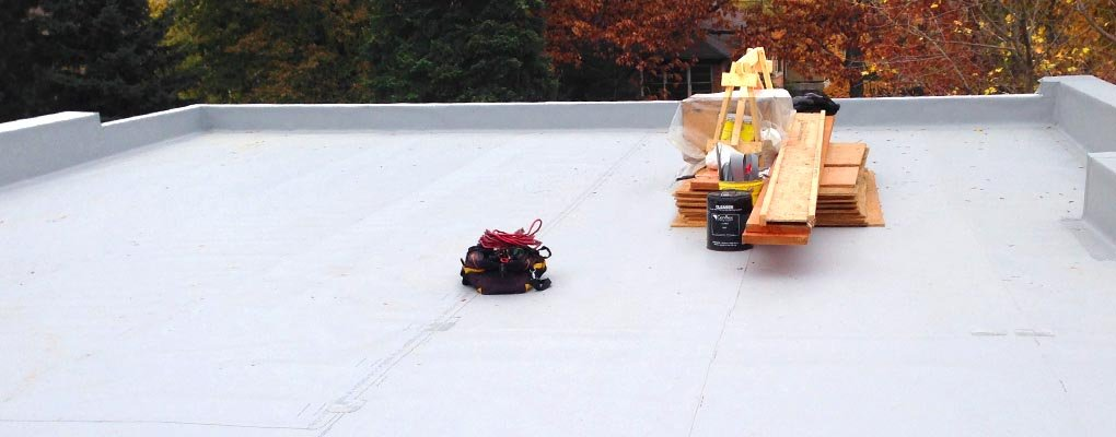 Working on Flat Roof in Mississauga