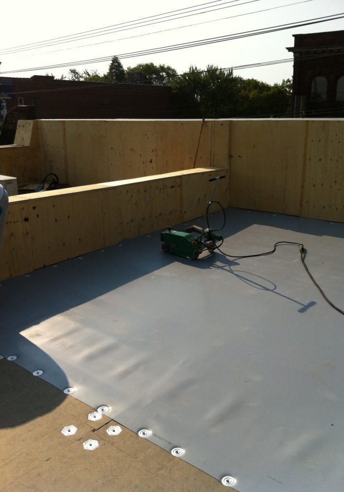 installing insulation and TPO membrane